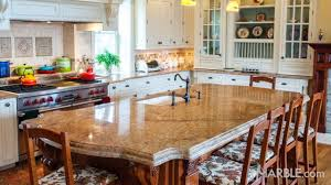 gold kitchen granite countertops with oak cabinets