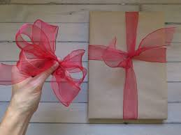 tying gift bows how to tie better bows 3 great ribbons to use
