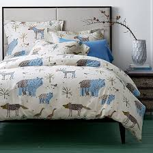 winter forest flannel duvet cover covered in whimsical trees and
