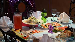 food tables at wedding reception panning shot of place setting at wedding reception food and drinks