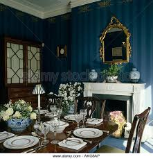 Dining Room Place Settings Interiors Blue Diningroom Traditional Stock Photos U0026 Interiors