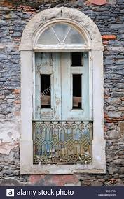 decaying old window in praia cape verde islands stock photo