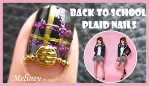 back to plaid nails with gold textured studs nail art