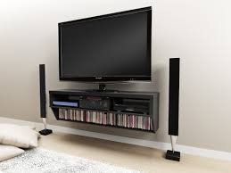 floating black wooden shelf with rectangle black led tv on grey