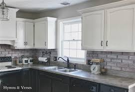 granite countertop white kitchen cabinets with dark hardwood