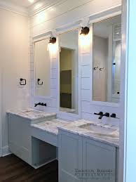 envision two oval mirrors keep the lighting and plank wall two