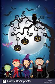 halloween background with little kids wearing halloween costume