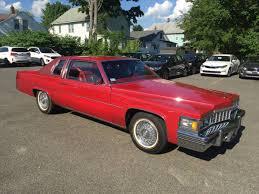 daily turismo red everywhere 1977 cadillac coupe de ville