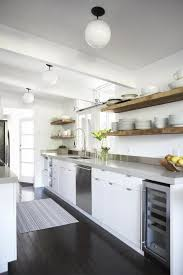 urban galley kitchen in eichler house white cabinets and floating