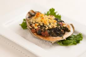 baked gulf oysters with country ham braised greens and cornbread