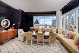 equinox ceo s midtown apartment is for sale asking 7 5m curbed ny as for the space itself it has floor to ceiling windows that offer views the city s skyline dramatic columns lacquered and hand painted walls