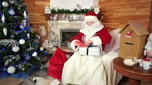 little girls helping santa with christmas gifts saint nicolas