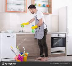 cleaning kitchen faucet cleaning kitchen faucet stock photo budabar 158335804