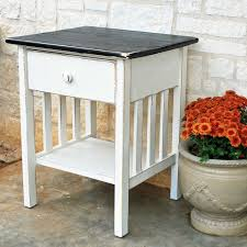 bedroom end table decor white wooden table with black counter top and single drawer also