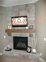 tv over corner fireplace design ideas above stone faced electric