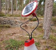 innovative solar powered lamp doubles as a cell phone charger