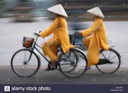 cdr bike girls in ao dai traditional vietnamese long dress and conical hat