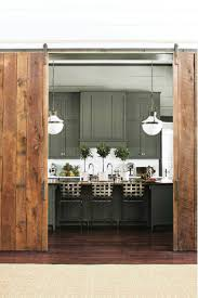 ideas in abundance as southern living design showcase opens in two massive wooden doors salvaged from a winchester tenn barn are turned into sliding doors to separate the living area from the kitchen