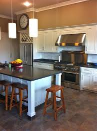 kitchen with white cabinets and hanging pendants over island with