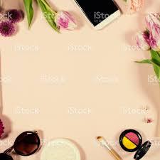 creative beauty feminine arrangement of flowers and cosmetics