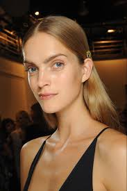 product for tucking hair behind ears narciso rodriguez center parted strands spritzed with shine and