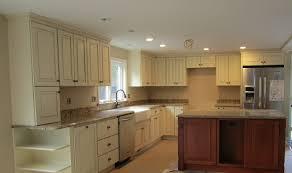 white kitchen blue gray walls dark cabinets grey island on green