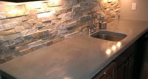 7 most popular types of kitchen countertops materials hgnv com view in gallery stained concrete kitchen countertops with backsplash