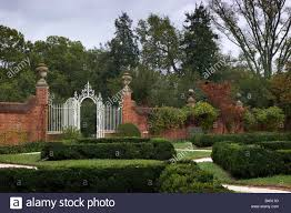 a wrought iron gate and ornaments in the formal garden of