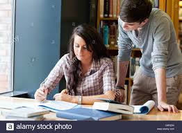 classmates search classmates helping each other stock photo royalty free image
