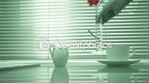 Flowers In A Book - life style house glass table with a book a cup of tea and milk