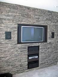 built in tv wall built in tv on textured stone wall tv wall pinterest stone