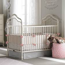 angelina iron crib is finished in the lovely soft linen