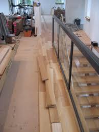Installing Stair Nose On Laminate Flooring Starting The Hardwood Floor Installation Barrettroad