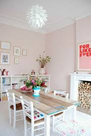 cute dining room with pastel wall colors and furnished with