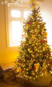 decorating beautiful balsam hill trees with cozy wooden floor