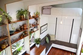 tiny house company bed automatically retracts up high in this contemporary tiny house