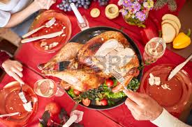family traditional thanksgiving turkey on a festive table