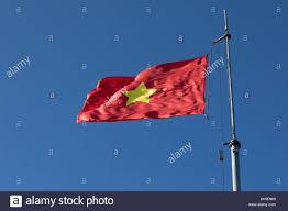 Viet Nam Flag Vietnam Flag On Top Pole Against Beautiful Clear Blue Sky Stock