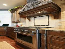 high end kitchen with peninsula plus black seating great brands