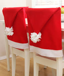 santa hat chair covers 7 ways to decorate your dining chairs for the holidays real simple