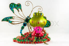 frog and dragonfly decorations on a white background
