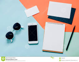 creative flat lay of workspace desk with smartphone stock photo