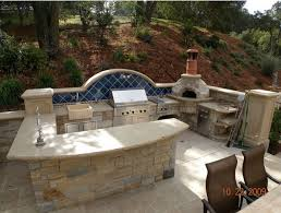 outdoor kitchen design outdoor kitchen designs featuring pizza ovens fireplaces and