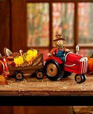 scarecrow on tractor figurine lighted pumpkins fall harvest