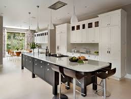 all there is to know about kitchen islands black kitchen island cabinets marble countertops and ceiling lamps