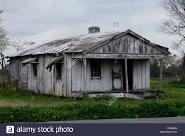 abandoned house roadside shack peeling paint louisiana stock