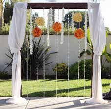 wedding arbor used great idea adorned with hanging pomanders strings of
