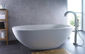 bathroom white egg shaped bathtub glass windows steel faucet grey