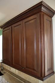 interesting dark brown maple wood crown molding for cabinets interesting dark brown maple wood crown molding for cabinets featuring double door wooden kitchen smlfimage source