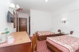 standard room with fan shower bath tub double twin u2013 fuji hotel